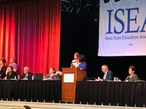 Amanda Crecelius on stage helping with NEA candidate questions