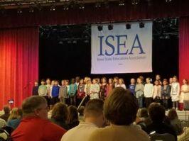 Student choir singing to start Saturday morning